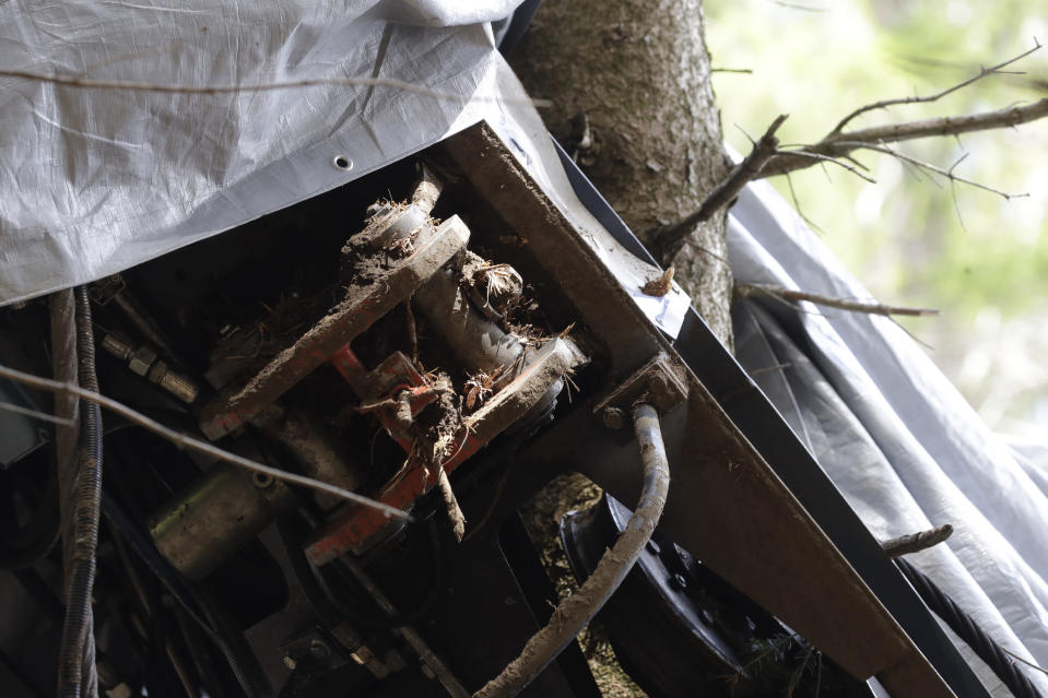 A view of a clamp that was placed on an emergency brake, as search for evidence continues in the wreckage of a cable car after it collapsed near the summit of the Stresa-Mottarone line in the Piedmont region, northern Italy, Wednesday, May 26, 2021. Police have made three arrests in the cable car disaster that killed 14 people after an investigation showed a clamp, placed on the brake as a patchwork repair effort, prevented the brake from engaging after the lead cable snapped. (AP Photo/Luca Bruno)