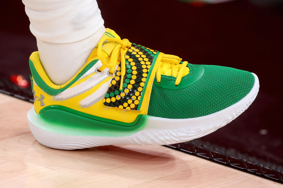 Patty Mills, part of Team Australia, wears these effervescent and vibrant Under Armour shoes during the men's basketball preliminary round group-B game at the Saitama Super Arena on July 25. - Credit: AP