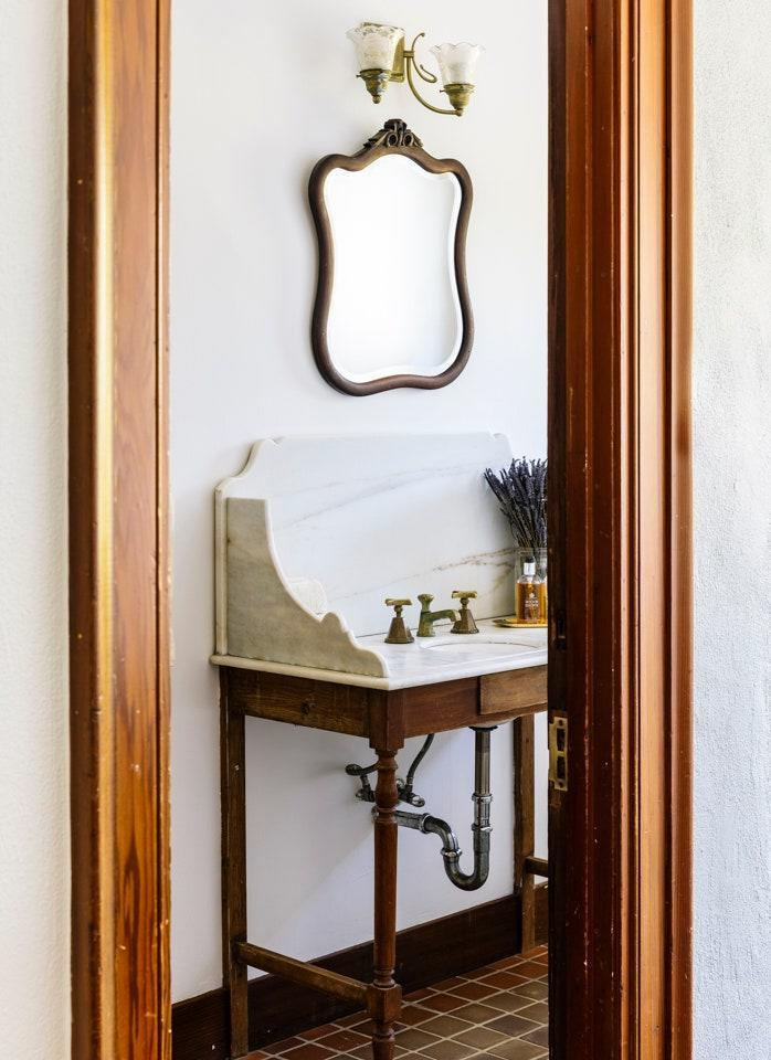 The wood-and-marble sink and fittings in this bathroom were original to the house.