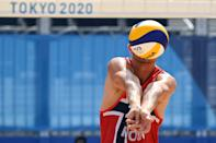<p>Norway's Christian Sandlie Sorum digs the ball in their men's beach volleyball quarter-final match between Russia and Norway during the Tokyo 2020 Olympic Games at Shiokaze Park in Tokyo on August 4, 2021. (Photo by Martin BERNETTI / AFP)</p>