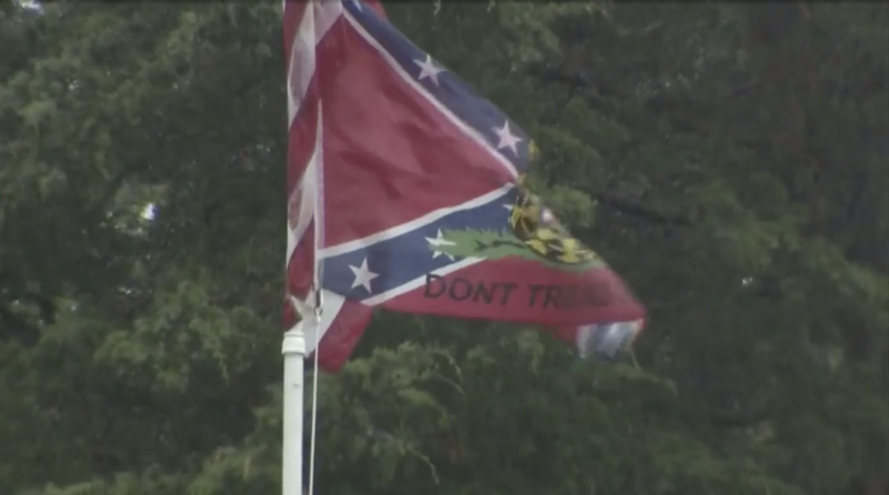 A man who flew Nazi and a flag of the Confederacy on his lawn, says he feels threatened by people's reactions. (Photo: WHDH)