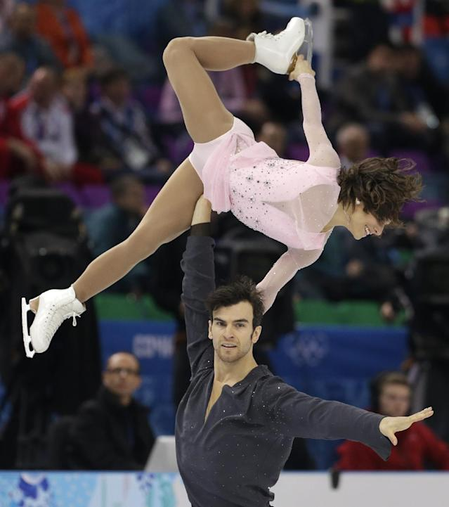 Meagan Duhamel and Eric Radford of Canada compete in the pairs short program figure skating competition at the Iceberg Skating Palace during the 2014 Winter Olympics, Tuesday, Feb. 11, 2014, in Sochi, Russia. (AP Photo/Darron Cummings)