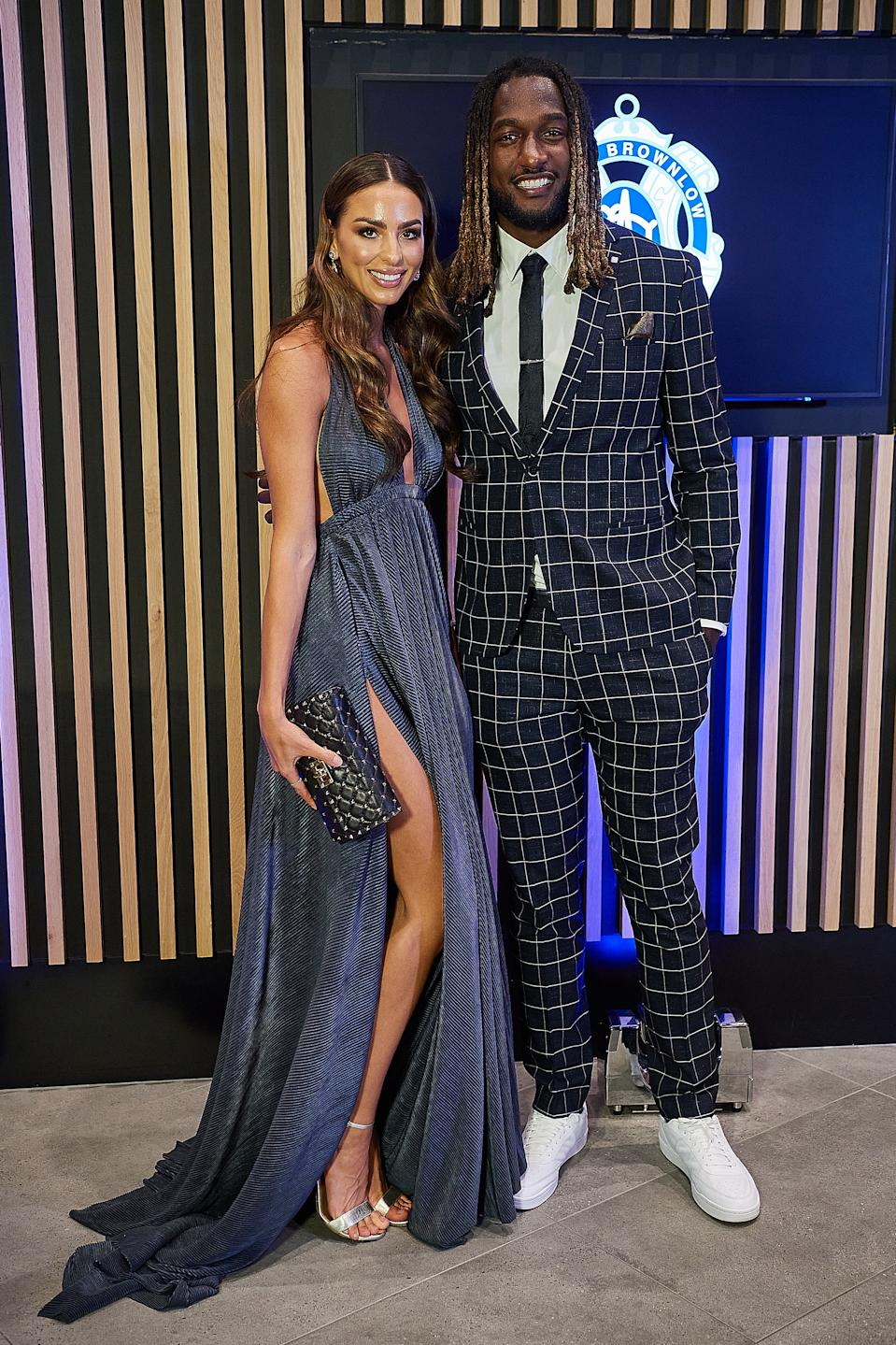 Nic Naitanui and partner Brittany Brown pose for a photo during the 2020 Brownlow Medal Count at Optus Stadium on October 18, 2020 in Perth, Australia.