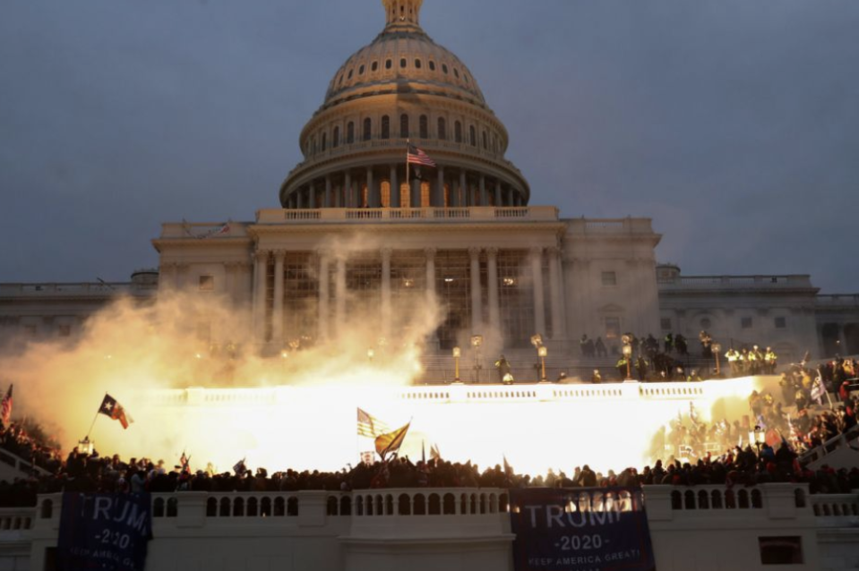 A dramatic explosion is caught on camera outside of the Capitol building amid pro-Trump riots. (Reuters)
