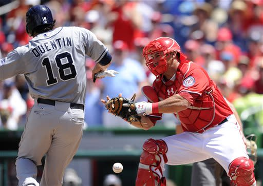 San Diego Padres' Carlos Quentin (18) is safe at home plate on a Chase Headley double as Washington Nationals catcher Wilson Ramos, right, looks for the ball during the third inning of a baseball game on Sunday, July 7, 2013, in Washington. (AP Photo/Nick Wass)