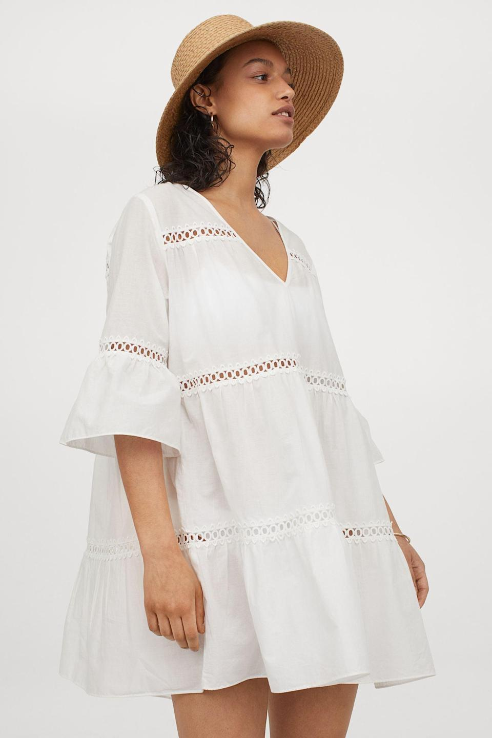 <p>Take a cue from the brand's styling, and wear this <span>Cotton Beach Dress</span> ($35) with a straw hat for a stylish beach day.</p>