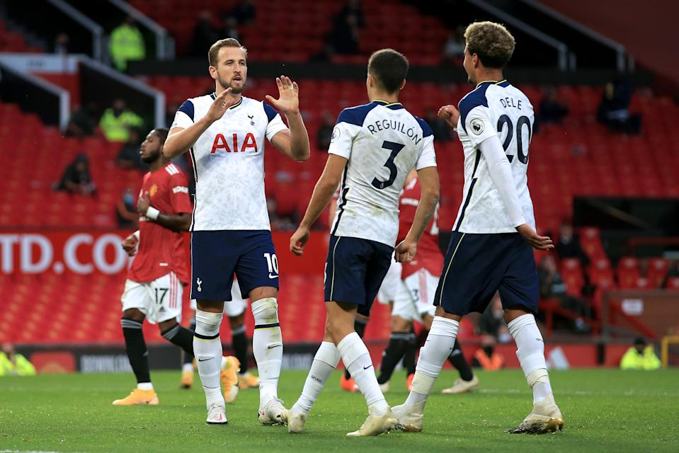 MANCHESTER, ENGLAND - OCTOBER 04: Harry Kane of Spurs celebrates scoring their 6th goal from the penalty spot with Sergio Reguilon and Dele Alli during the Premier League match between Manchester United and Tottenham Hotspur at Old Trafford on October 4, 2020 in Manchester, United Kingdom. Sporting stadiums around the UK remain under strict restrictions due to the Coronavirus Pandemic as Government social distancing laws prohibit fans inside venues resulting in games being played behind closed doors. (Photo by Simon Stacpoole/Offside/Offside via Getty Images)