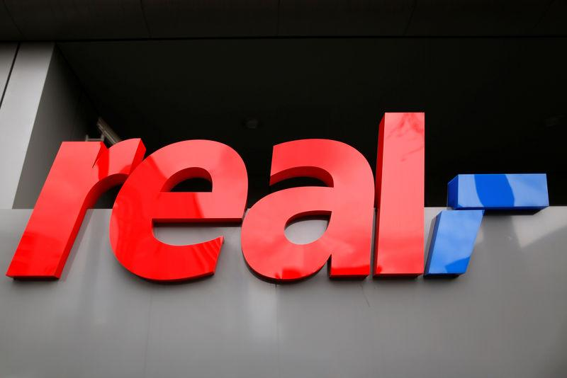 FILE PHOTO: A sign of consumer market Real, which belongs to German retailer Metro, is seen at their headquarters in Dusseldorf, Germany, March 30, 2016. REUTERS/Ina Fassbender/File Photo