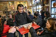 Tea is served -- some auction houses double as cafes, bringing organisers an alternative revenue stream