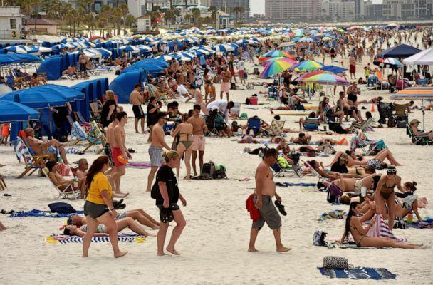 FILE PHOTO: People crowd the beach, while other jurisdictions had already closed theirs in efforts to combat the spread of novel co (Steve Nesius/Reuters)