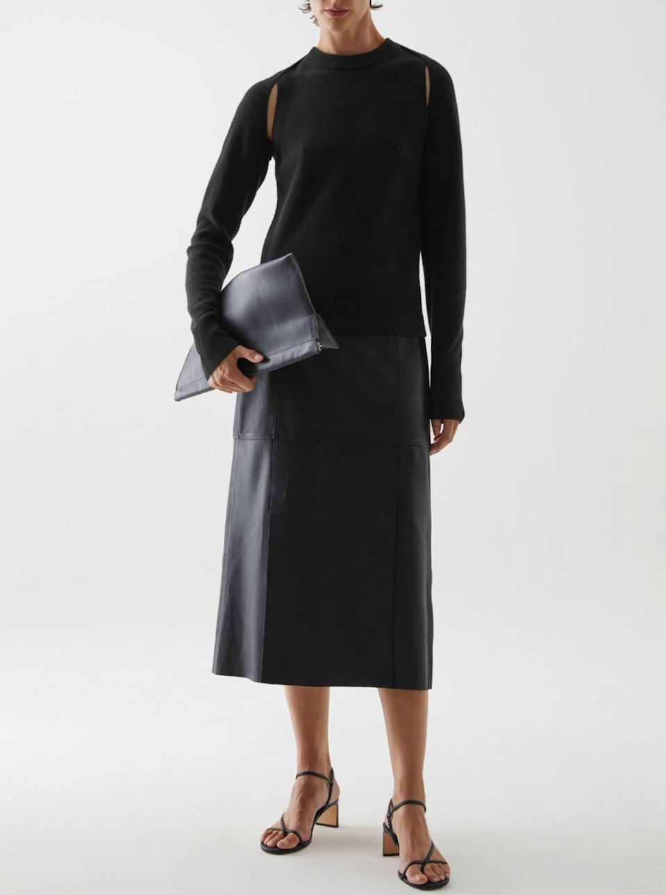 """Offset a delicate cashmere shrug by pairing it with a leather skirt for an all-black look that's anything but boring. $150, Cos. <a href=""""https://www.cosstores.com/en_usd/women/accessories/product.cashmere-cropped-shrug-black.0941074001.html"""" rel=""""nofollow noopener"""" target=""""_blank"""" data-ylk=""""slk:Get it now!"""" class=""""link rapid-noclick-resp"""">Get it now!</a>"""