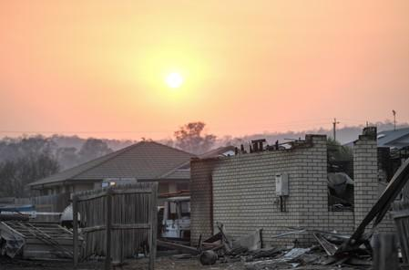 A house burnt down by bushfires is seen in Laidley