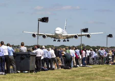 The Airbus Industrie A380 aircraft comes into land after its display at the 2014 Farnborough International Airshow in Farnborough