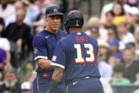 American League's Aaron Judge, of the New York Yankees, left, greets Salvador Perez, of the Kansas City Royals, after scoring on a base hit by Marcus Semien, of the Toronto Blue Jays, during the second inning of the MLB All-Star baseball game, Tuesday, July 13, 2021, in Denver. (AP Photo/Jack Dempsey)