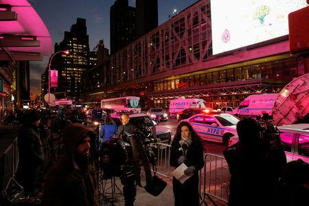 Members of the media gather by the New York Port Authority bus terminal following an attempted detonation during the morning rush hour in New York City, New York, U.S., December 11, 2017.  REUTERS/Andrew Kelly