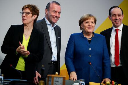 CDU party leader Annegret Kramp-Karrenbauer, Manfred Weber, member of the Christian Social Union party, CSU, and top candidate of the European People's Party (EPP) for the European elections, German Chancellor Angela Merkel and leader of the CDU state group of Brandenburg, Ingo Senftleben attend a strategy meeting of Germany's governing Christian Democratic Union (CDU) party in Potsdam, Germany, January 14, 2019. REUTERS/Axel Schmidt