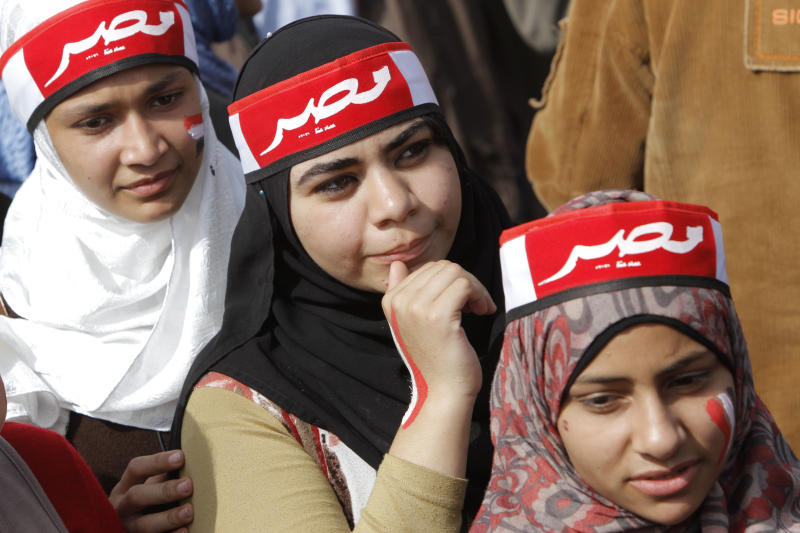 "Egyptian pro-military supporters wear scarves with Arabic reading, ""Egypt,"" during a protest in Cairo, Egypt, Friday, March 1, 2013. Hundreds of pro-military supporters gathered to reject the Muslim Brotherhood and President Mohammed Morsi's rule calling for the military to return to power. (AP Photo/Amr Nabil)"