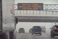 Traffic passes a sign warning of a winter storm, Monday, Jan. 25, 2021, in Des Moines, Iowa. A major winter storm is expected to blanket a large swath of the middle of the country with snow Monday and disrupt travel as more than a foot of snow falls in some areas. (AP Photo/Charlie Neibergall)