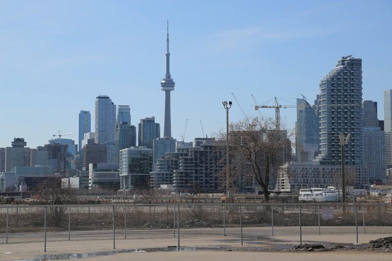 The downtown skyline and CN Tower are seen past the eastern waterfront area of Toronto