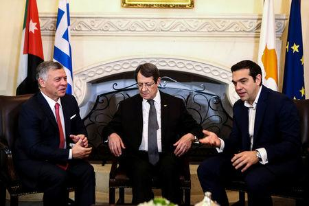 Cypriot President Nicos Anastasiades (C), Greek Prime Minister Alexis Tsipras (R) and Jordan's King Abdullah talk during a meeting at the Presidential Palace in Nicosia, Cyprus January 16, 2018. REUTERS/Iakovos Hatzistavrou/Pool
