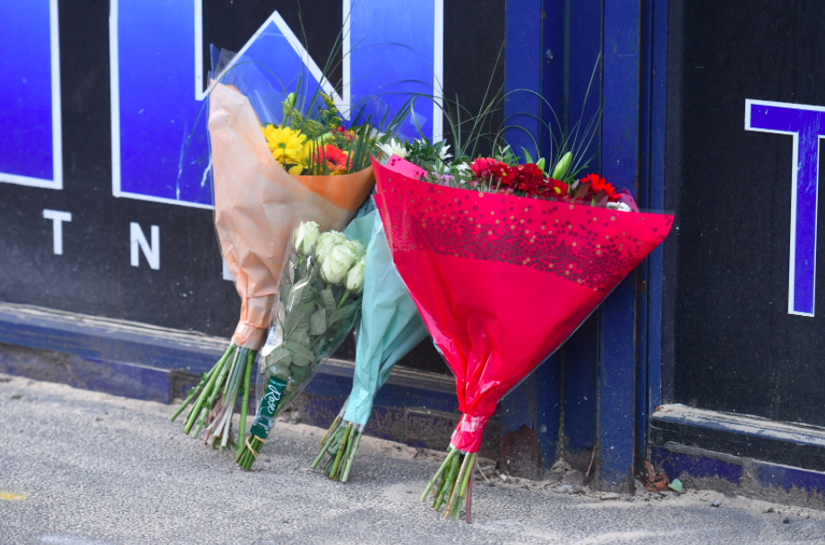 <em>Flowers were left at the scene of the stabbing (PA)</em>
