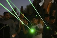 Lasers are directed towards the windows of homes in the settlement