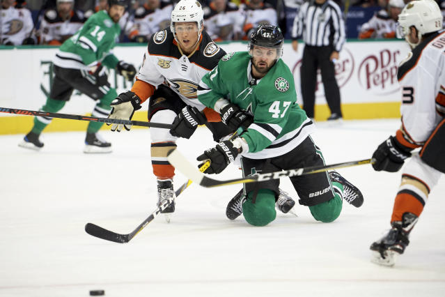 Dallas Stars right wing Alexander Radulov (47), of Russia, battles for the puck with Anaheim Ducks defenseman Brandon Montour (26) during the first period of an NHL hockey game Saturday, Oct. 13, 2018, in Dallas. (AP Photo/Cooper Neill)