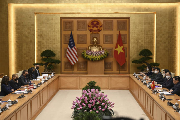 U.S. Vice President Kamala Harris, left, and Vietnamese Prime Minister Pham Minh Chinh, right, attend a meeting at the government office in Hanoi, Vietnam, Wednesday, Aug. 25, 2021. Harris turns her focus to the coronavirus pandemic and global health during her visit to Vietnam, a country grappling with a worsening surge in the virus and stubbornly low vaccination rates. (Manan Vatsyayana/Pool Photo via AP)