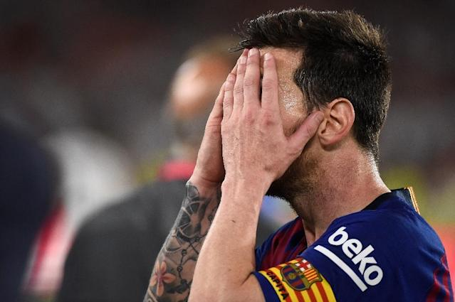 A dejected Lionel Messi could provide his team with nothing more than a consolation goal (AFP Photo/JOSE JORDAN )