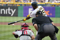 Pittsburgh Pirates' Gregory Polanco, top right, singles off Philadelphia Phillies starting pitcher Vince Velasquez, driving in a run, during the first inning of a baseball game in Pittsburgh, Friday, July 30, 2021. (AP Photo/Gene J. Puskar)
