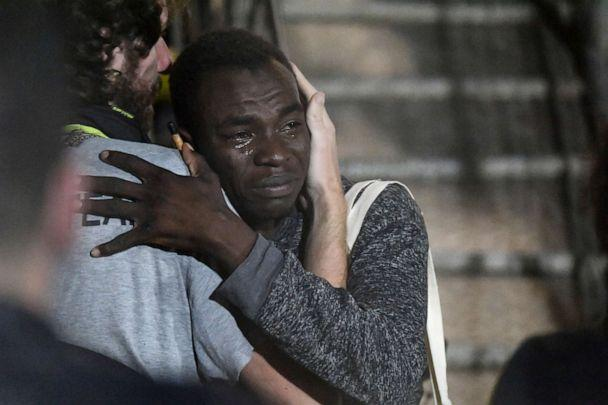 PHOTO:A man cries as he hugs a crew member after disembarking from the Open Arms rescue ship on the Sicilian island of Lampedusa, southern Italy, Aug. 20, 2019. (Salvatore Cavalli/AP)