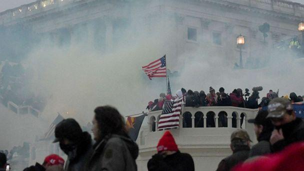PHOTO: Police clear the U.S. Capitol Building with tear gas as supporters of President Donald Trump gather outside, in Washington, Jan. 6, 2021. (Stephanie Keith/Reuters)