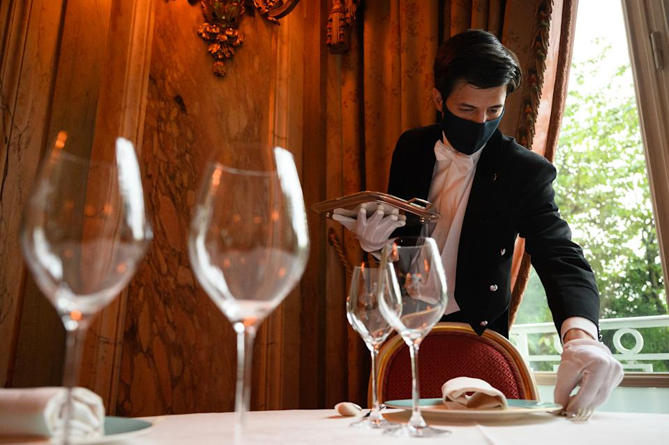 LONDON, ENGLAND - MAY 13: Chef De Rang Giacomo Monti lays a table in the restaurant at The Ritz London on May 13, 2021 in London, England. After closing its doors in the middle of December, The Ritz London is preparing to welcome guests on May 17, when coronavirus restrictions will be eased to allow hotels across the United Kingdom to re-open. (Photo by Leon Neal/Getty Images)