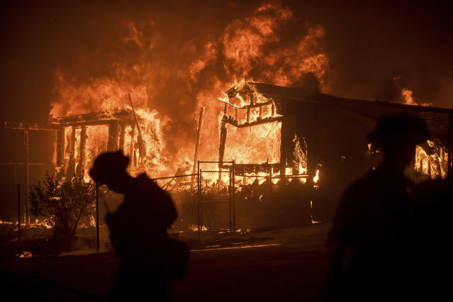 <p>Flames from a wildfire consume a residence near Oroville, Calif., on Sunday, July 9, 2017. Evening winds drove the fire through several neighborhoods leveling homes in its path. (AP Photo/Noah Berger) </p>