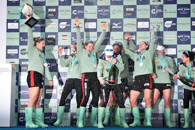Rowing - 2018 Oxford University vs Cambridge University Boat Race - London, Britain - March 24, 2018 Cambridge women's celebrate winning the boat race with the trophy REUTERS/Toby Melville