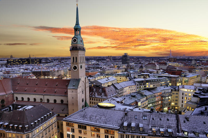 City Centre of Munich with old Town Hall light up taken during sunset. Germany