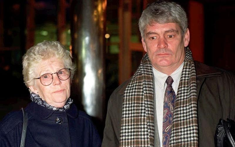 Alastair Morgan and his mother, Isobel Hulsmann, arriving at Scotland Yard in 1997 - PA