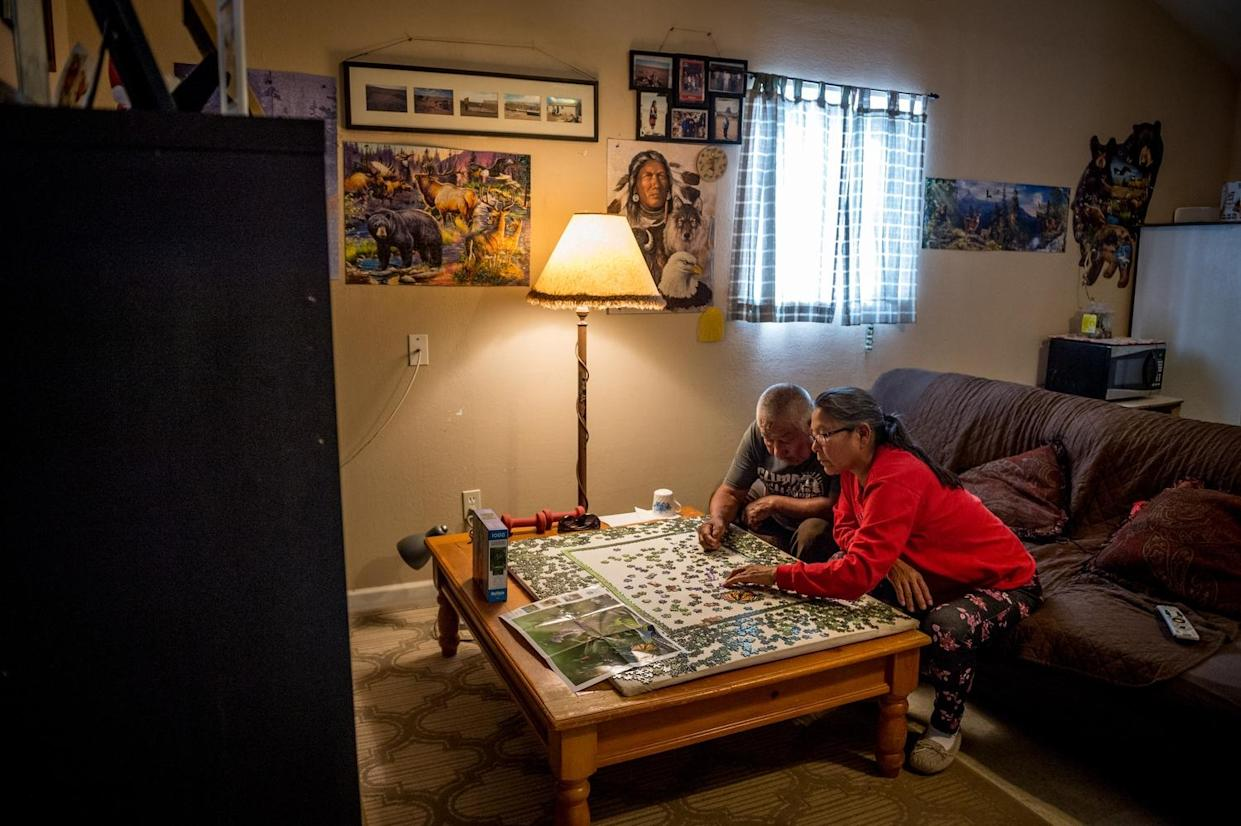 Leona Talker is pictured putting a puzzle together with her father, Tommy Talker. (Photograph by Mary F. Calvert)