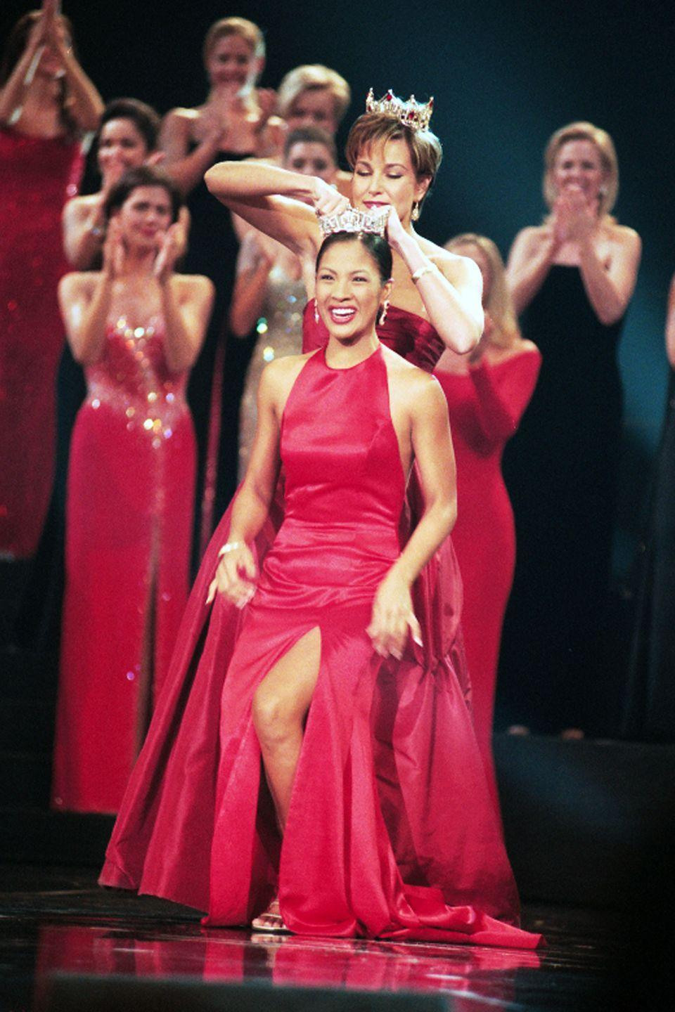 <p>Angela Perez Baraquoi from Hawaii made a statement in a fiery red halter gown in 2001. </p>