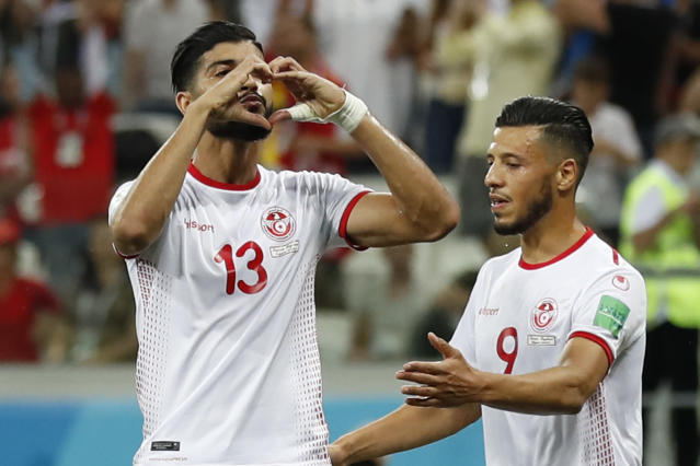 Tunisia's Ferjani Sassi, left, celebrates with teammate Anice Badri after scoring from the penalty spot his side's first goal during a group G match against England at the 2018 soccer World Cup in the Volgograd Arena in Volgograd, Russia, Monday, June 18, 2018. (AP Photo/Alastair Grant)