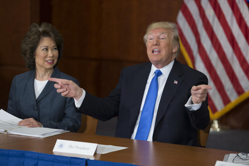 WASHINGTON, DC - JUNE 09: US President Donald Trump (R) participates in the 'Roads, Rails, and Regulatory Relief roundtable meeting', beside Secretary of Transportation Elaine Chao (L) at the Department of Transportation on June 9, 2017 in Washington, DC. (Photo by Michael Reynolds-Pool/Getty Images)