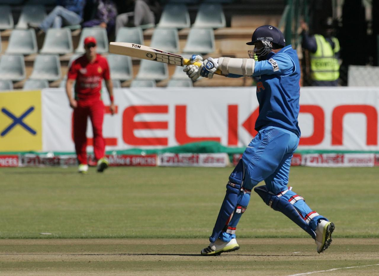 India's Dinesh Karthik bats during the 2nd match of the 5 match cricket ODI series between hosts Zimbabwe and India at Harare Sports Club on July 26, 2013. AFP PHOTO /Jekesai Njikizana.        (Photo credit should read JEKESAI NJIKIZANA/AFP/Getty Images)