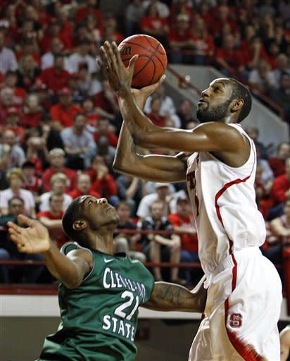 North Carolina State's C.J. Leslie (5) shoots the ball over Cleveland State's Marlin Mason (21) during the first half of an NCAA college basketball game in Raleigh, N.C., Saturday, Dec. 8, 2012. (AP Photo/Karl B DeBlaker)