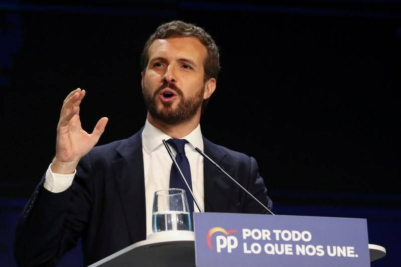 FILE PHOTO: Spain's People's Party (PP) leader Pablo Casado attends a campaign closing rally ahead of general election, in Madrid