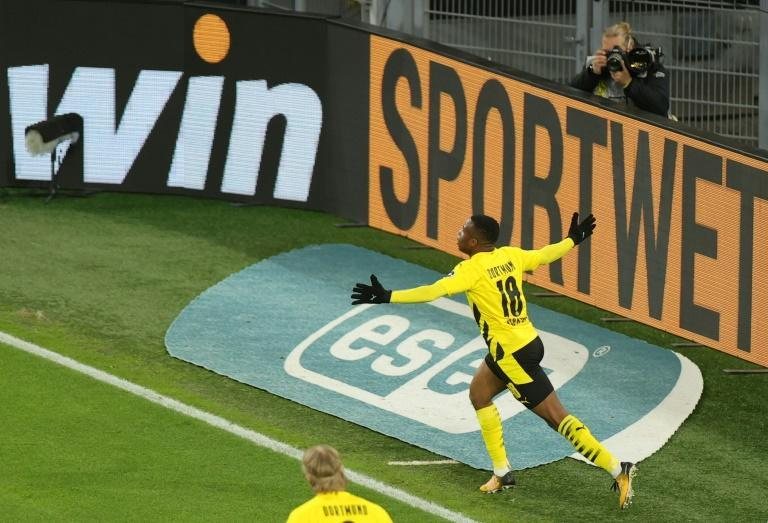 Dortmund striker Youssoufa Moukoko, 16, celebrates his goal against Hertha Berlin