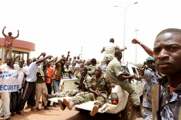 PHOTO: Supporters of Mali's junta participate in a demonstration against regional bloc ECOWAS (Economic Community of West African States) at the international airport of Bamako, March 29, 2012. (Luc Gnago/Reuters, FILE)