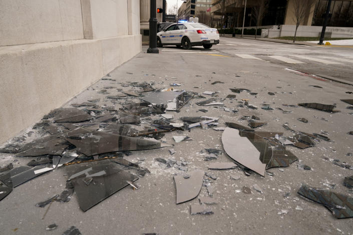Broken window glass is scattered near the scene of an explosion in downtown Nashville, Tenn., Friday, Dec. 25, 2020. Buildings shook in the immediate area and beyond after a loud boom was heard early Christmas morning. (AP Photo/Mark Humphrey)