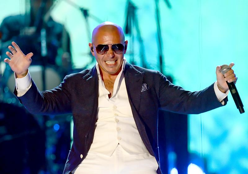 LAS VEGAS, NV - APRIL 08:  Recording artist Pitbull performs onstage during Tim McGraw's Superstar Summer Night presented by the Academy of Country Music at the MGM Grand Garden Arena on April 8, 2013 in Las Vegas, Nevada.  (Photo by Ethan Miller/Getty Images)
