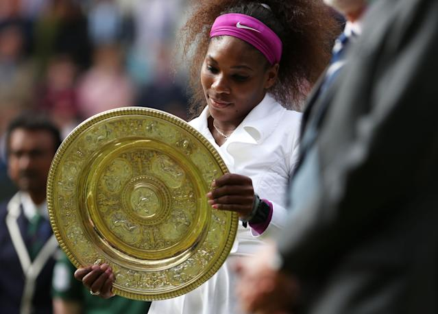 LONDON, ENGLAND - JULY 07: Serena Williams of the USA holds the winners trophy after her Ladies? Singles final match against Agnieszka Radwanska of Poland on day twelve of the Wimbledon Lawn Tennis Championships at the All England Lawn Tennis and Croquet Club on July 7, 2012 in London, England. (Photo by Julian Finney/Getty Images)