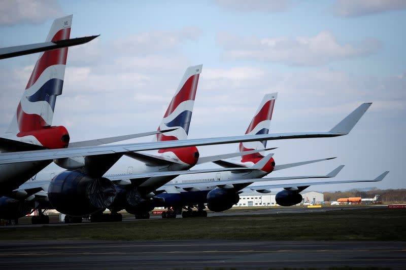 BA suspends more than 30,000 staff, owner scraps dividend